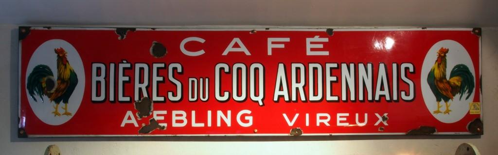 Bières_du_Coqq_Ardennais,_Café_A._Ebling_Vireux_,_enamel_advertising_sign_at_the_Musée_Européen_de_la_Bière
